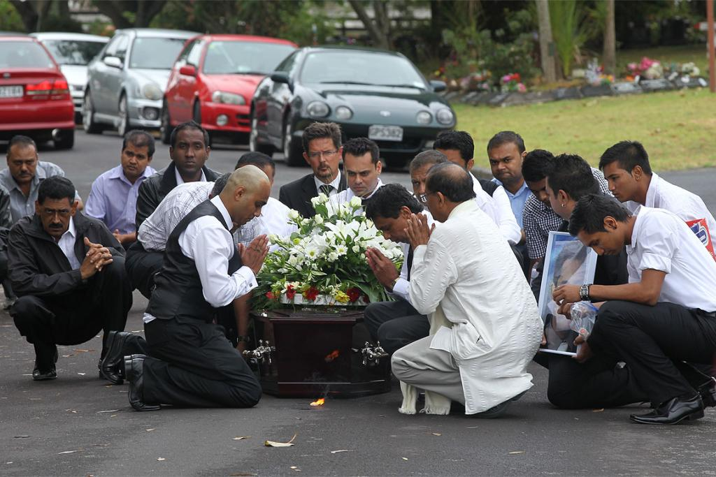Family and friends gather at Manukau Memorial Gardens for the funeral of Shalvin Prasad.
