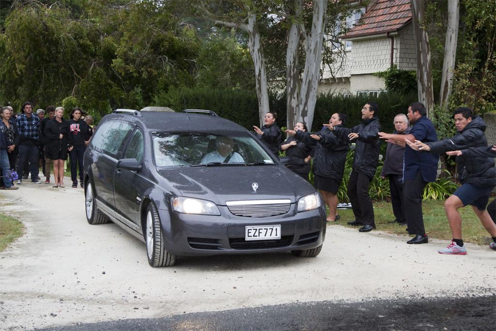 Local iwi perform a haka as the body of Sir Paul Holmes is taken from his Hawke's Bay property.