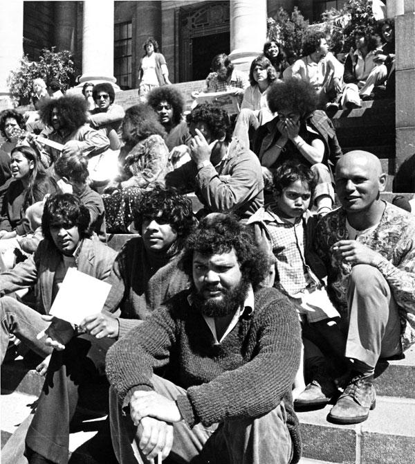 Four Australians join the Maori land protestors in the grounds of Parliament. From left, Gary Foley, Gary Williams and brothers Charlie and Ross Watson. The four were founders of the Aborigine tent embassy set up in the grounds of the Australian parliament in 1972. Photo taken 1975.