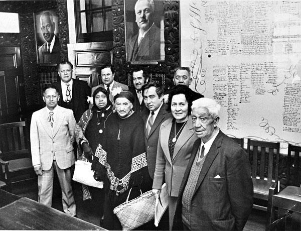 Taranaki Maori in Parliament's Maori Affairs room before meeting a government caucus committee over claims for compensation stemming from confiscation of land in the 1860s. Pictured at back from left: Hamiora Raumati, Maui Pomare, Neville Baker, Makare Love. At front from left: Hoani Meremaia, Mrs Moe Reweti, Mrs Sally Karena, Ralph Love (negotiator), Mrs Matekitawhiti Carr (secretary) and Pehi Tamati (chairman).