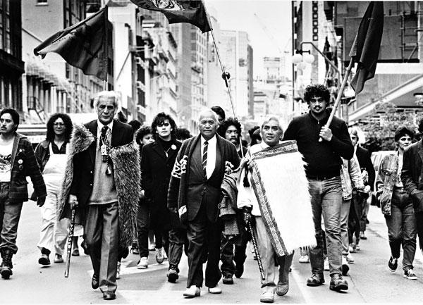 Kaumatua (elders) Henare Sutherland (left), Matiu Tarawa (centre) and Robert Pene lead Ngati Whatua and supporters on a march to mark the tenth anniversary of the eviction at Bastion Point. Photo taken in 1988.