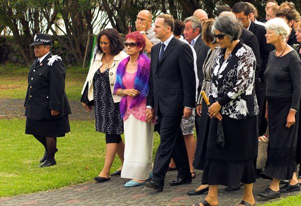 Titewhai Harawira centre, leads National Party leader John Key onto the Te Tii Marae, Bay of Islands in the build up to Waitangi Day celebrations in 2008.