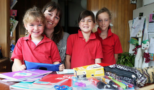 Sacha Sayers stocks up on school stationery for her daughters, from left, Eve, 5, Kendal, 7, and Autumn 9, during the year to keep back-to-school costs down.