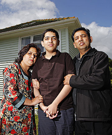 DRIVER 'COULDN'T HANDLE IT': Porirua Taxis manager Raj Gordon, right, with his autistic son Sameer and wife Monika.