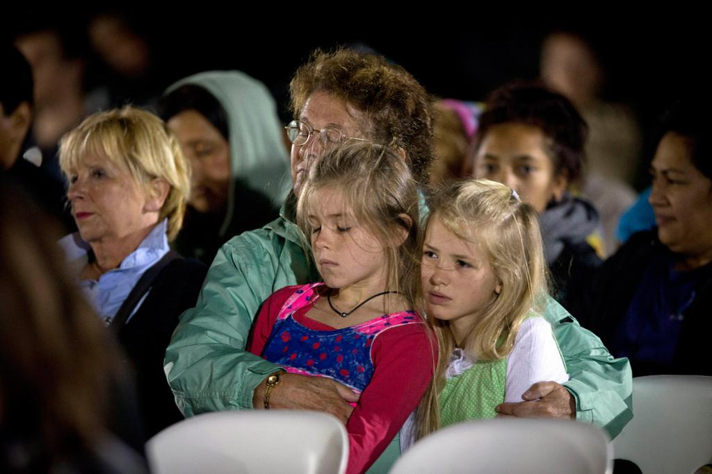 A child rests her eyes at the dawn service.