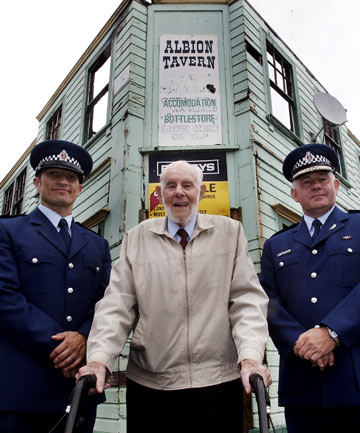 Police historian Ray Carter, centre, with Shannon Constable Charlie Rudd, left, and Central District area commander Superintendent Russell Gibson