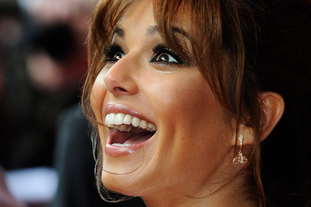 Cheryl Cole's dimpled cheeks were also rating well among people wanting plastic surgery.