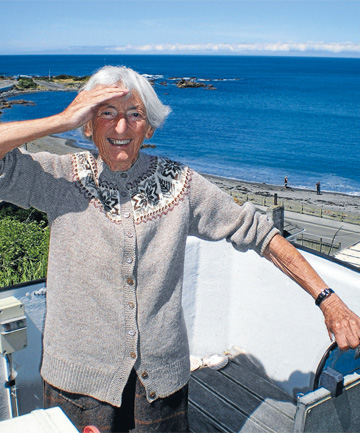 Sheila Natusch on her Owhiro Bay clifftop, with Stewart Island far over the horizon, but ever-present in the imagination.