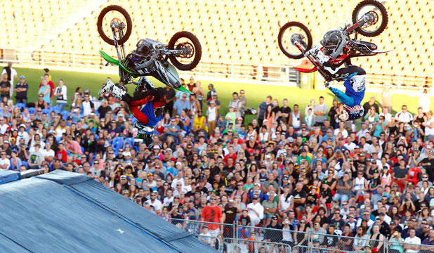 HANG TIME: Two bikers display their skills on the big ramps on Wednesday.