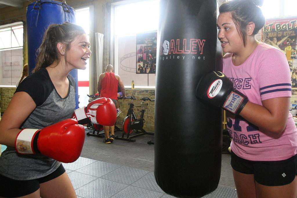 BOXING BOOTCAMP: Manurewa High School students Katherine Wijohn (left) and Jasmine Teleiai work together to get fit for Round the Bays.