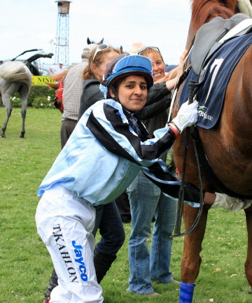 SUCCESSFUL: Taminder Kahlon unsaddles her first winner,  Sandfly, at Riverton yesterday.