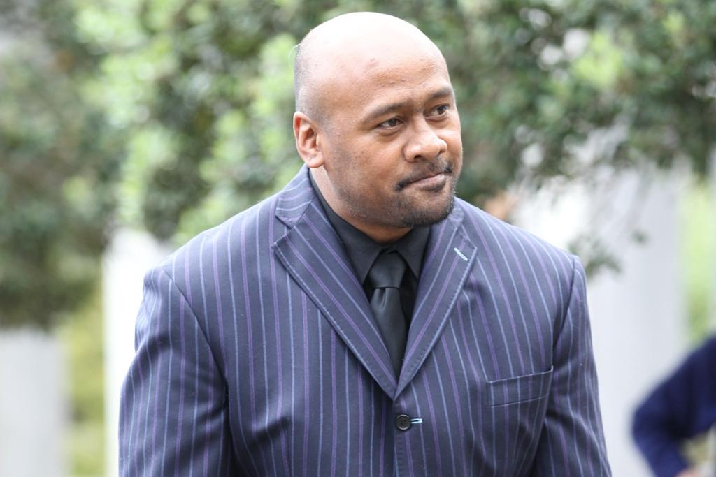 Rugby great Jonah Lomu arrives at the funeral of Sir Paul Holmes.