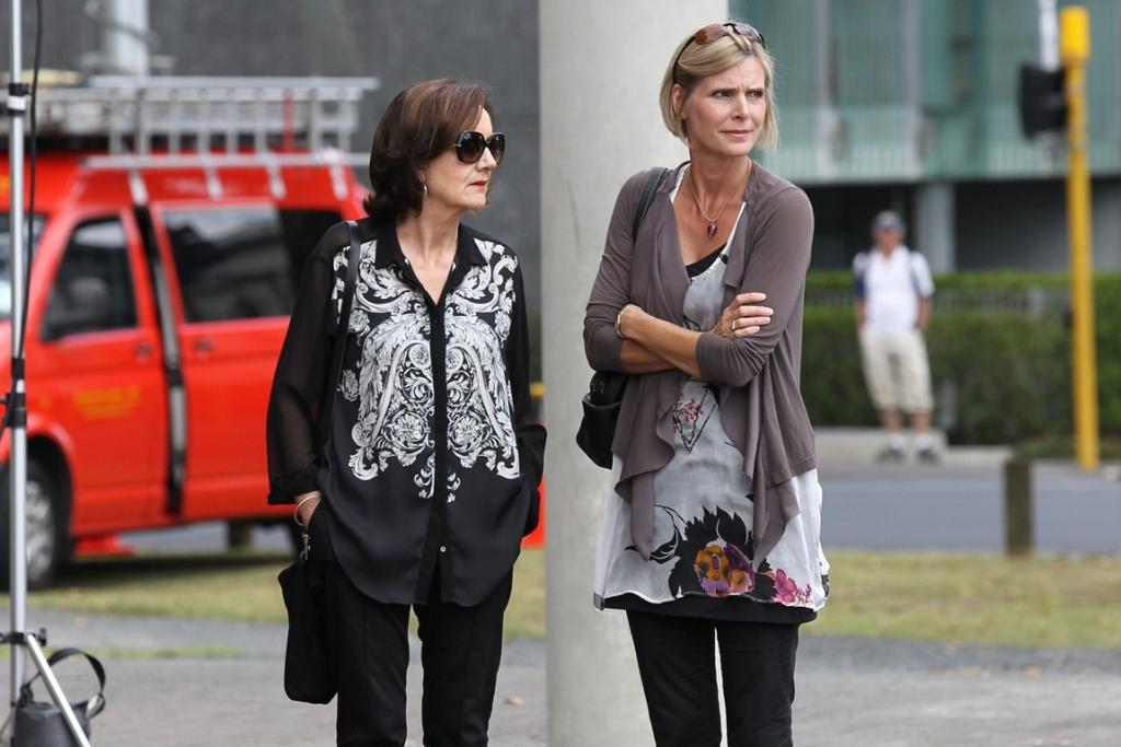 Mourners, including TV presenter Jude Dobson, right, arrive at the funeral of Sir Paul Holmes.
