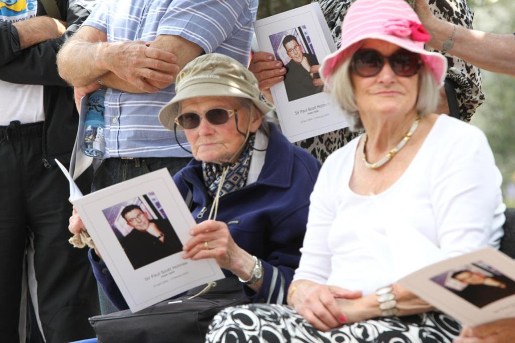 Mourners at the funeral of Sir Paul Holmes.