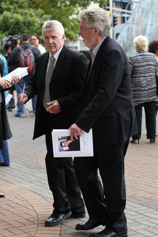 Brendon Telfer, right, and Phil Gifford arrive at the funeral for Sir Paul Holmes.
