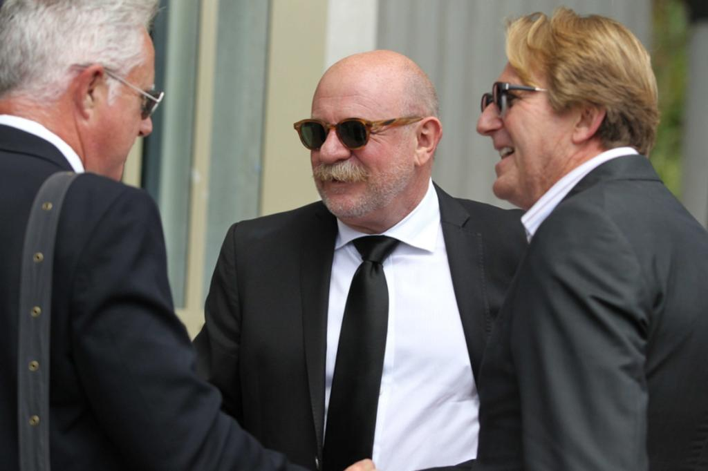 From left to right, Mark Crysall, Mark Sainsbury and Cameron Bennett arrive at the funeral for Sir Paul Holmes.