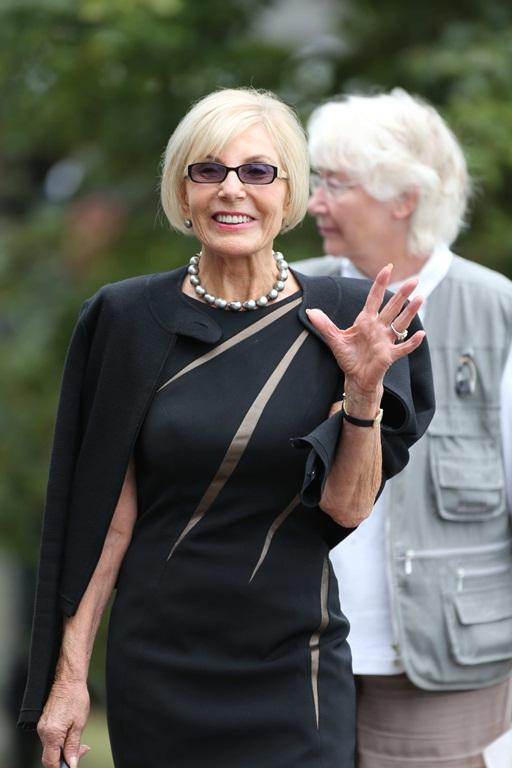 Dame Rosie Horton arrives at the funeral for Sir Paul Holmes.
