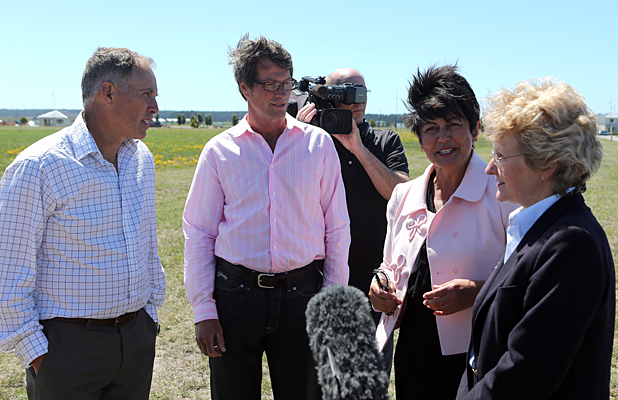 Waikuku School principal Roger Hornblow, board chairman Nigel Sharplin, Education Minister Hekia Parata and Waimakariri MP Kate Wilkinson discuss the announcement of a new Pegasus school.