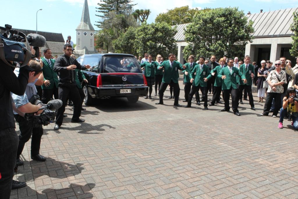 The service concluded with a combination of bagpipes and a haka performed by Karamu High School students.