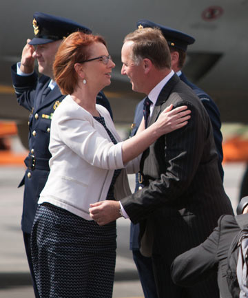 GIDDAY MATE: Australian prime minister Julia Gillard is greeted by New Zealand prime minister John Key on arrival in Queenstown ahead of their weekend meetings.