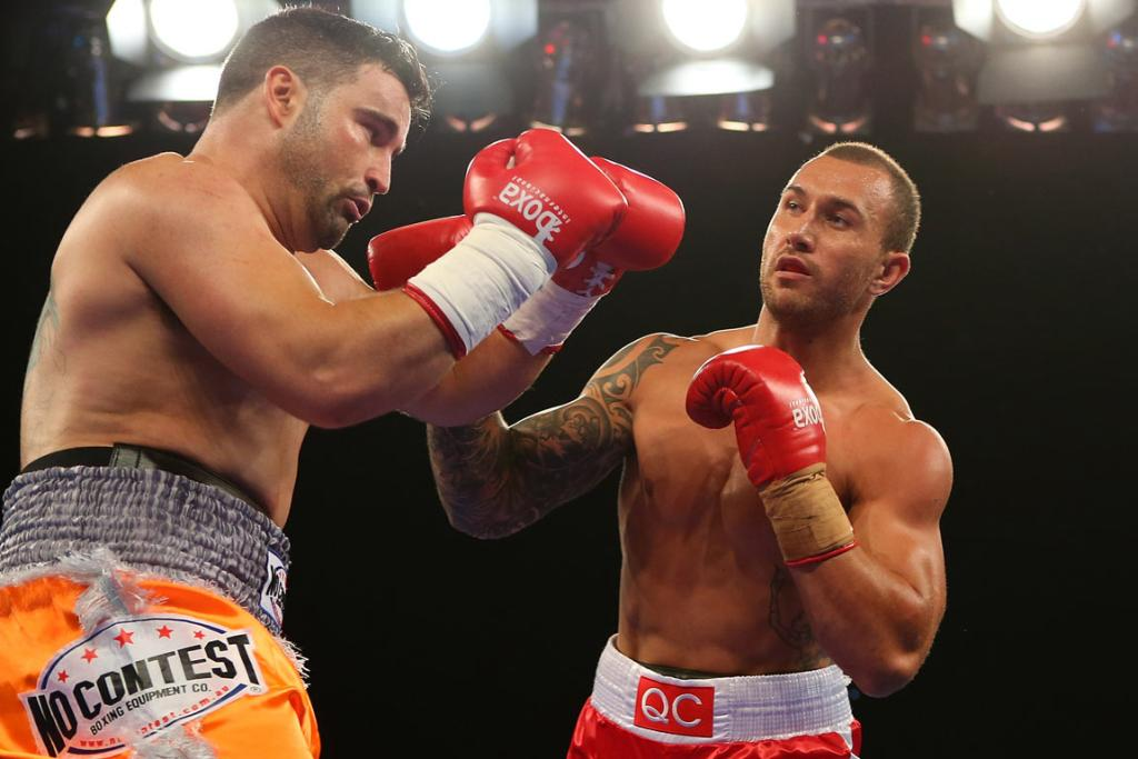 Quade Cooper, in his boxing debut, lands a punch on Barry Dunnett.