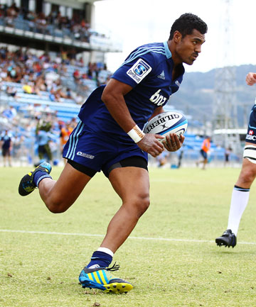 TRY TIME: Lolagi Visinia runs in a try for the Blues.