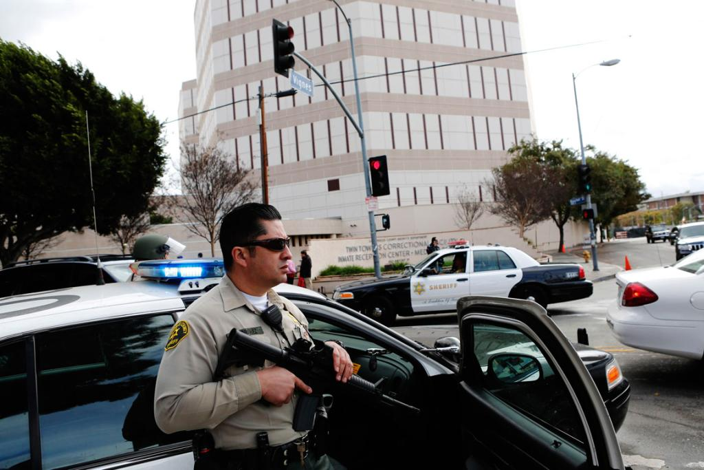 LA County Sheriff Deputies with rifles and shotguns keep watch outside of the Twin Towers Jail on February 8 (local time), in response to a unconfirmed sighting of Christopher Dorner.