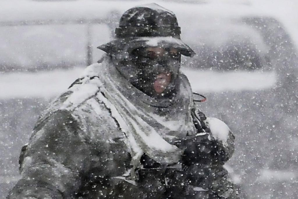 A Los Angeles county sheriff SWAT member prepares to continue the search for Christopher Dorner in the heavy snow at the Bear Mountain ski resort at Big Bear Lake, California.