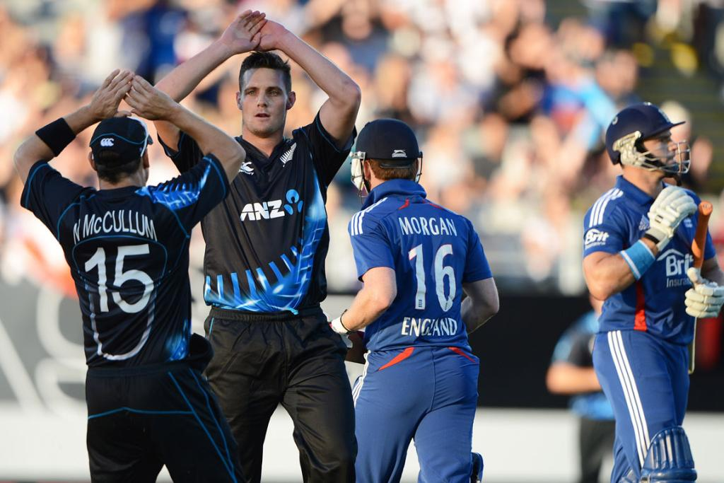 New Zealand's Mitchell McClenaghan celebrates the dismissal of Michael Lumb.