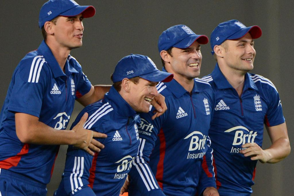England players celebrate the dismissal of Brendon McCullum.