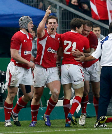 LOSING, OVER: Wales' George North (second left) celebrates with team-mates after his late try sealed a 16-6 victory over France in Paris.