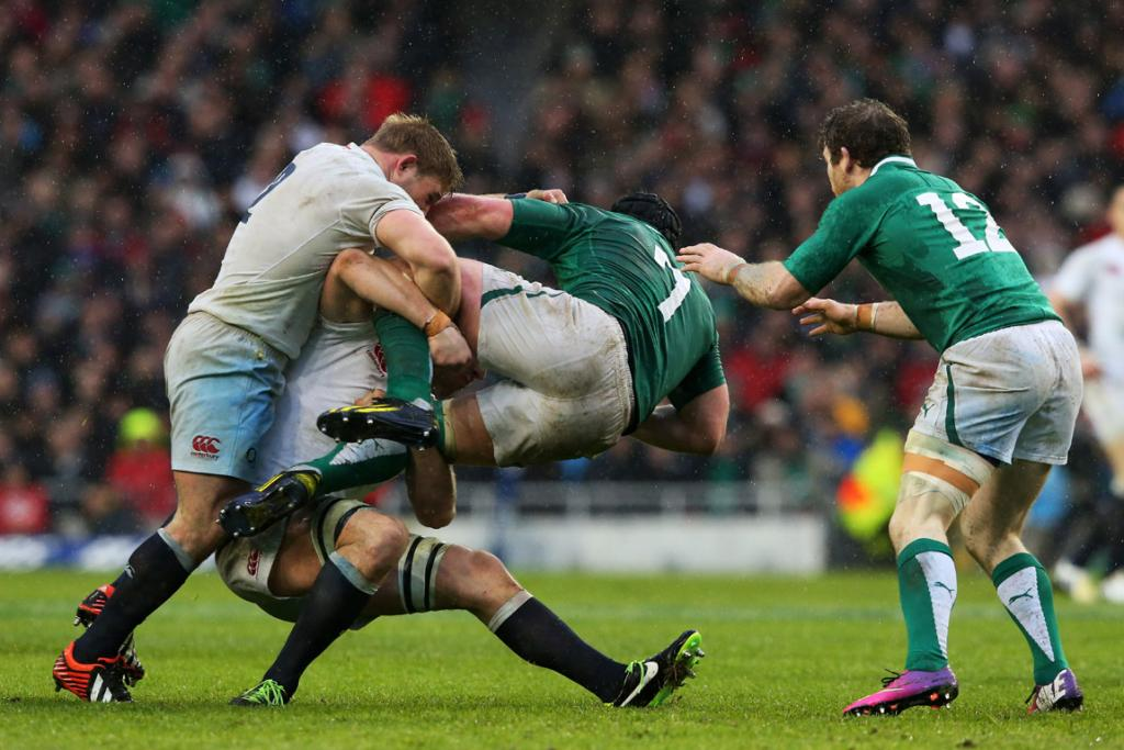 Sean O'Brien of Ireland is tackled by Tom Youngs and Chris Robshaw of England.