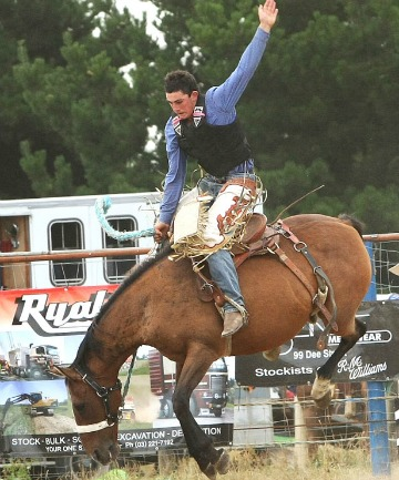 Southland cowboy Wade Marshall shows his style while competing in the Open Saddle Bronc section of the Southland Rodeo.