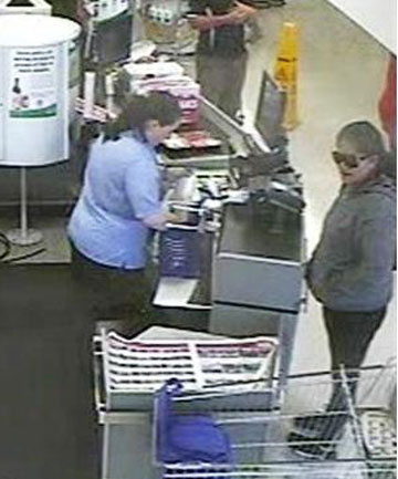WANTED: Police want to identify the woman wearing sunglasses in this CCTV image following the theft of eftpos cards.