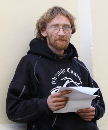 Invercargill man Chris Hodgkinson whose wife Natasha Harris, died in February 2010. Mr Hodgkinson believes she died from the large amounts of Coke she drank every day. He is pictured with a copy of the prelimary autopsy report.