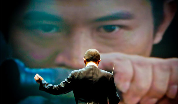 ORIGINAL SOUNDTRACK: ''I'm like a magician. I'm looking at the screen and holding my symphonic magical baton and creating a sound, according to the pictures passing along,'' says composer Tan Dun.