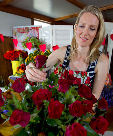 Valentines Day: Amy Henwood from Amy's Flowers filling Valentines Day orders for absent-minded blokes.