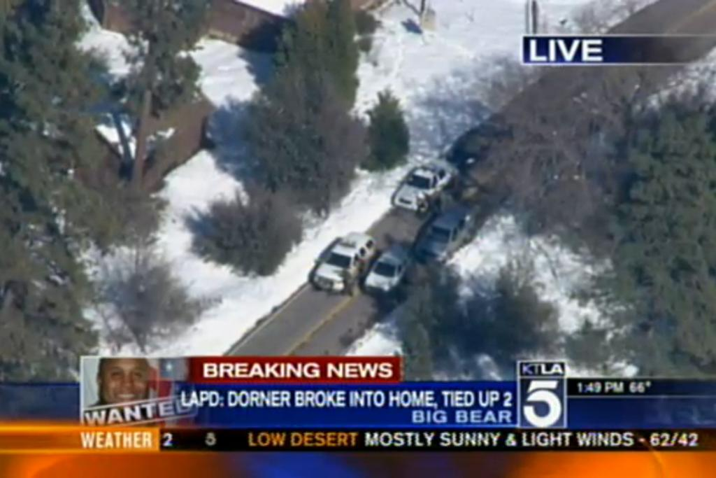 A screenshot from KTLA5 shows authorities involved in the hunt for Christopher Dorner at Big Bear, on February 13.