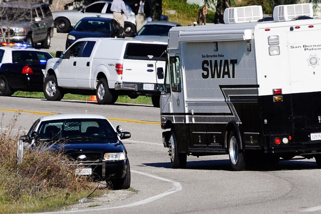 Authorities move into position during a manhunt for former LAPD officer Christopher Dorner.
