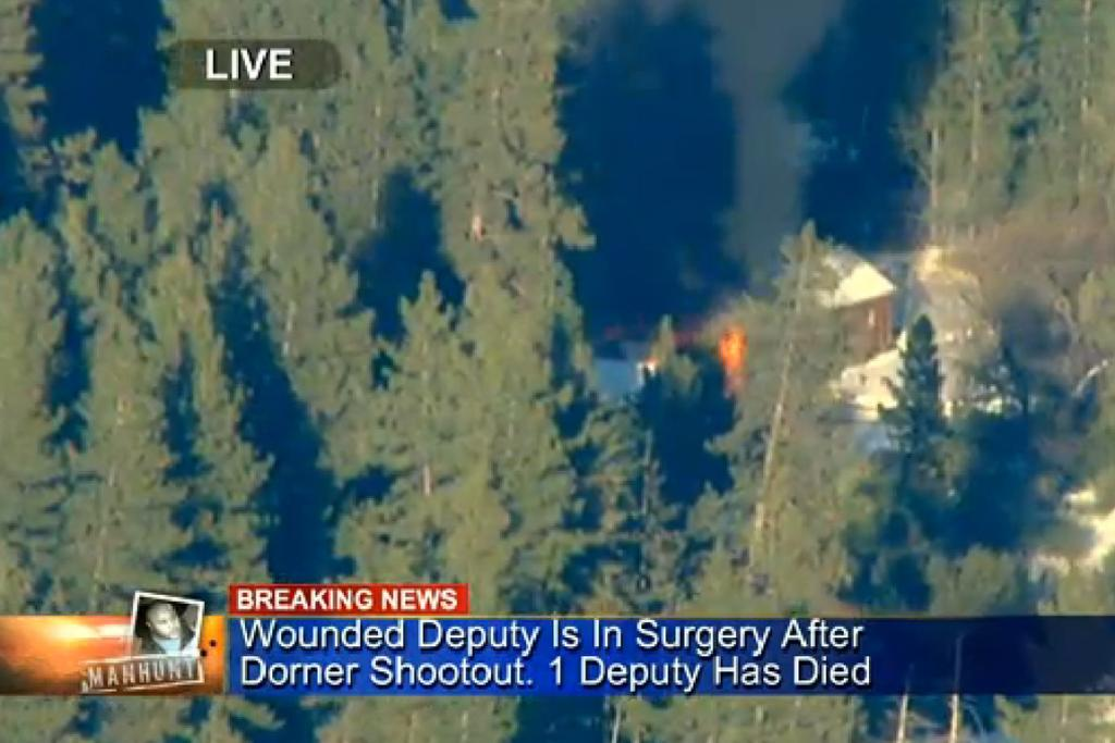 A CBS screenshot shows flames and smoke coming from the cabin where fugitive Christopher Dorner was believed to be hiding.