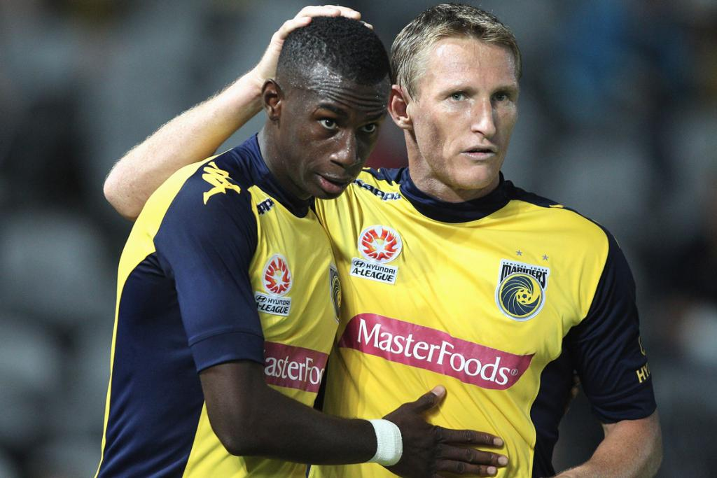 Bernie Ibini (left) and Daniel McBreen celebrate a goal for Central Coast Mariners.