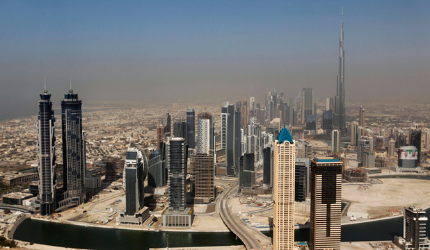 MONSTROUS: Dubai's skyscrapers are seen with the Burj Khalifa, the tallest tower in the world at a height of 828 metres. A 210m-tall Ferris wheel will soon be the newest addition to the skyline.