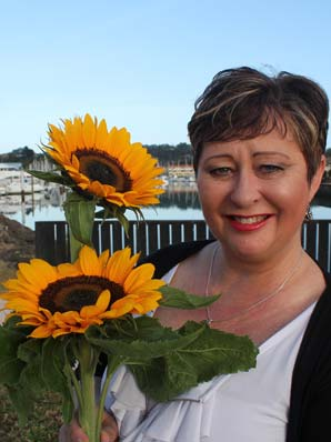 SHINING HOPE: Make-A-Wish chief executive Carolyn MacDonell says a sunflower can be picked for a gold coin donation at its fundraiser festival.