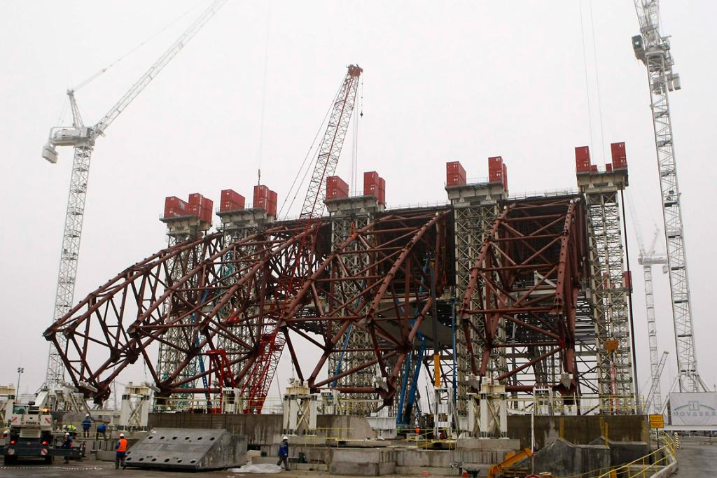 Staff work on the New Safe Confinement structure at the site of the Chernobyl nuclear reactor in November 2012. It will be placed over the existing sarcophagus, will have a span of 247m and weigh 29,000 tonnes.