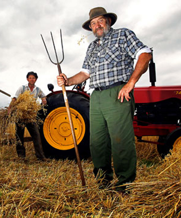 BACK IN TIME: Taranaki's prolonged dry spell has seriously dented farmers' ability to make enough fodder for next winter, but it won't deter these blokes from demonstrating how oats were harvested bac