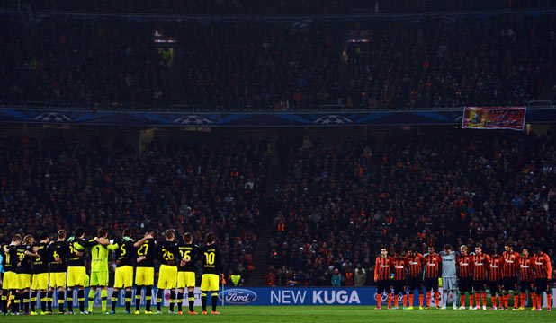 SILENT NIGHT: Players from Borussia Dortmund (left) and Shakhtar Donetsk observe a minute's silence to honour the Dortmund fans who died in a plane crash before the Champions League match.