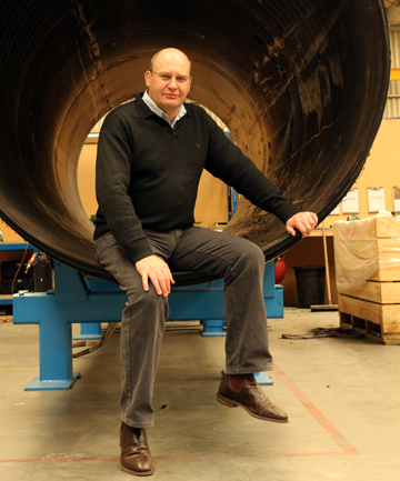 GOOD PROSPECTS: Bryan Wilson, general manager of Frank PKS in Christchurch, with the firm's $3 million large pipe-making machine.