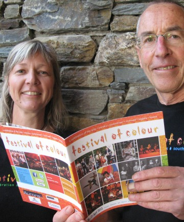 Festival of Colour general manager Lindsey Schofield and director Philip Tremewan peruse the festival's programme.