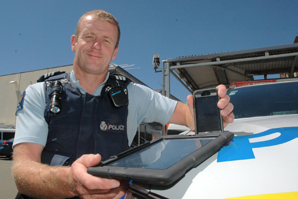 Inspector gadget: Police sergeant Bruce Cook, with devices trialled here that are improving front line officers abilities on the beat.