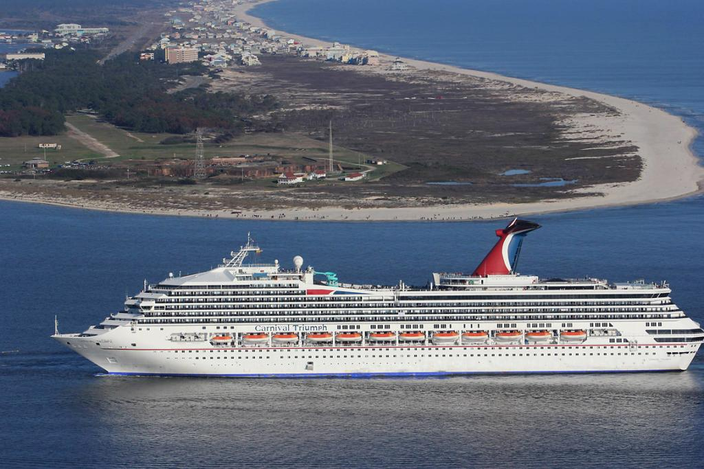 The Carnival Triumph cruise ship is towed towards the port of Mobile, Alabama.